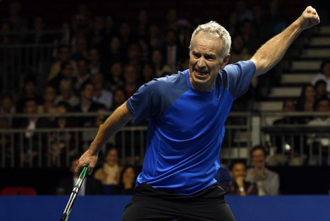 John McEnroe of the U.S. reacts after winning a point during his BNP Paribas Showdown friendly tennis match against compatriot Ivan Lendl in