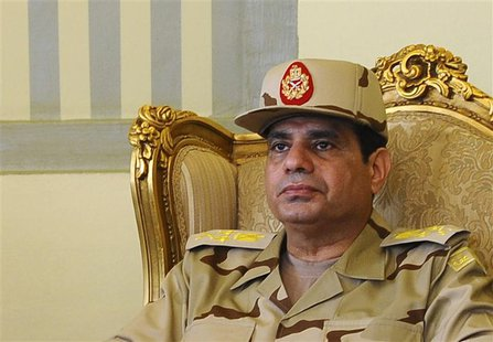Egypt's Defense Minister Abdel Fattah al-Sisi is seen during a news conference in Cairo on the release of seven members of the Egyptian secu