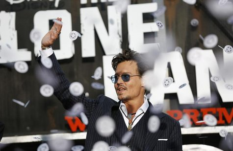 "Cast member Johnny Depp waves as confetti fly at the world premiere of ""The Lone Ranger"" at Disney California Adventure Park in Anaheim, Cal"