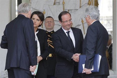 Newly-named Ecology and Energy Minister Philippe Martin (R) shakes hands with French President Francois Hollande (2ndR) next to Prime Minist