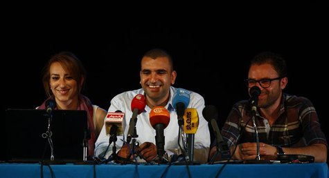 Mohamed Bennour (C), coordinator of the Tunisia Tamarod (rebel) movement, speaks at a news conference in Tunis July 3, 2013. REUTERS/Zoubeir