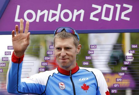 Canada's Ryder Hesjedal gestures at the start of the men's cycling road race at the London 2012 Olympic Games July 28, 2012. REUTERS/Phil No