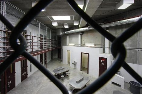 The interior of an unoccupied communal cellblock is seen at Camp VI, a prison used to house detainees at the U.S. Naval Base at Guantanamo B
