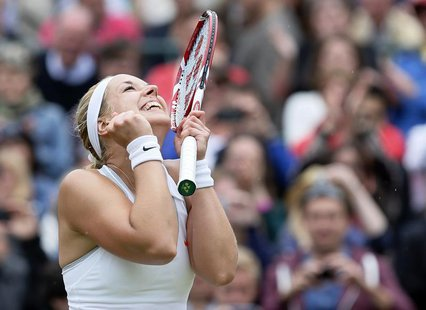 Sabine Lisicki of Germany celebrates after defeating Kaia Kanepi of Estonia in their women's quarter-final tennis match at the Wimbledon Ten