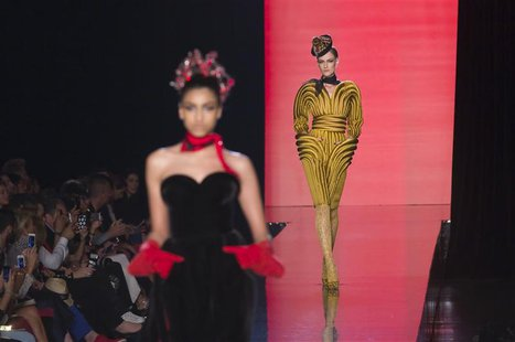 Models present creations by French designer Jean Paul Gaultier as part of his Haute Couture Fall Winter 2013/2014 fashion show in Paris July