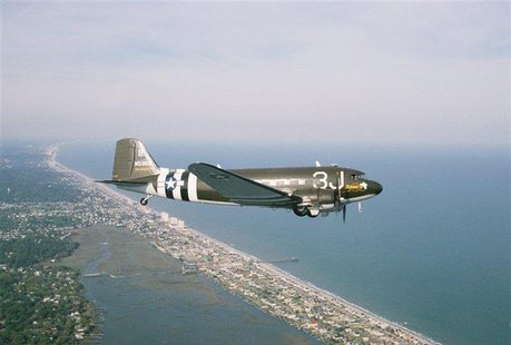 South Carolina pilot Barry Avent flies his World War II DC-3 C-47 cargo plane near Myrtle Beach, South Carolina in this 2008 file photo. Ave