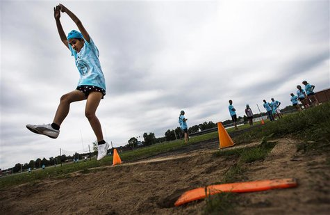 Dah Ku participates in long jump at Camp Abilities in Brockport, New York, June 25, 2013. REUTERS/Mark Blinch
