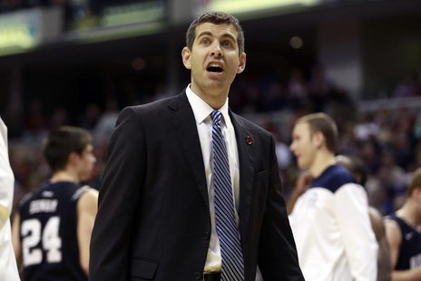 Butler University head coach Brad Stevens questions an official's call during the second half of an NCAA basketball game against Indiana Uni