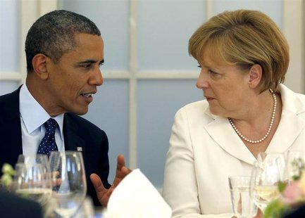 U.S. President Barack Obama and German Chancellor Angela Merkel (R) chat during at the Chralottenburg Castle in Berlin June 19, 2013. REUTER