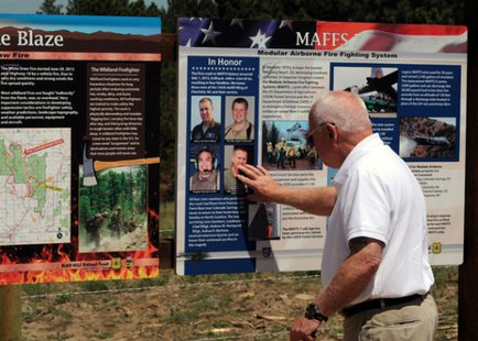 A memorial ceremony was held  to dedicate an interpretive site that honors the Airmen of the North Carolina Air National Guard (NCANG) C-130 aircraft that crashed one year ago today while fighting the White Draw Fire near Edgemont. - (sdang.gov)