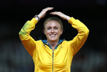 Australia's Sally Pearson reacts on the podium before being presented with the gold medal for the women's 100m hurdles at the London 2012 Ol