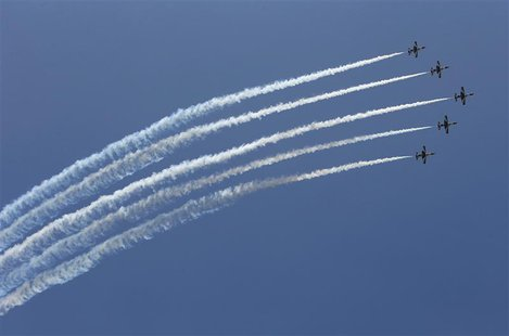 Egyptian military jets fly in formation over Cairo as the head of Egypt's constitution court Adli Mansour is sworn in as the interim head of