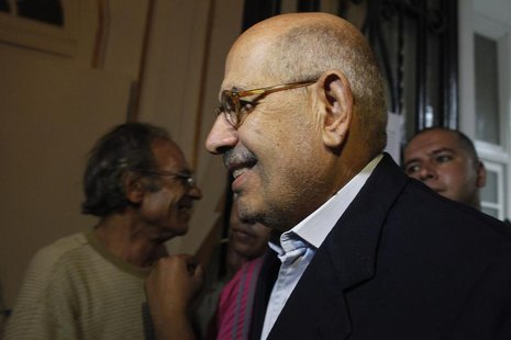 Senior opposition figure Mohamed ElBaradei arrives to speak with anti-Mursi protesters made up of intellectuals and artists inside Egypt's M