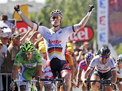 Lotto-Belisol team rider Andre Greipel (C) of Germany celebrates as he wins the 176.5 km fifth stage of the centenary Tour de France cycling