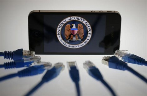 An illustration picture shows the logo of the U.S. National Security Agency on the display of an iPhone in Berlin, June 7, 2013. REUTERS/Paw
