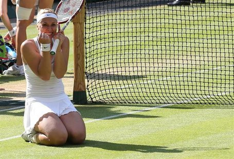 Sabine Lisicki of Germany celebrates after defeating Agnieszka Radwanska of Poland in their women's semi-final tennis match at the Wimbledon