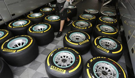 Pirelli tyres of Germany's Mercedes Formula One driver Nico Rosberg are checked at the Nuerburgring July 4, 2013. The German F1 Grand Prix w