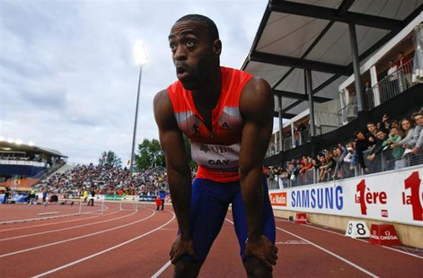 Tyson Gay of the U.S. reacts after winning in the 100m event of the Lausanne Diamond League meeting in Lausanne, July 4, 2013. REUTERS/Denis