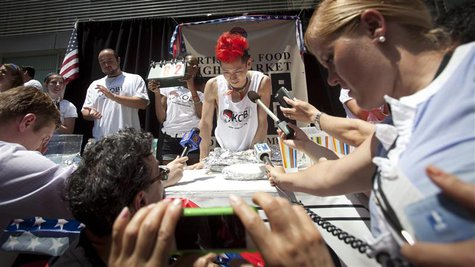 Competitive eater Takeru Kobayashi is interviewed after competing in a hot dog eating competition in New York, July 4, 2013. Kobayashi ate 6