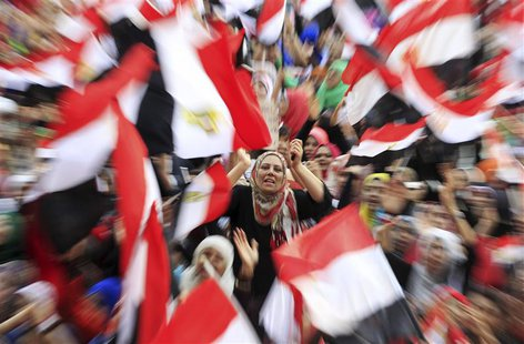 Protesters against ousted President Mohamed Mursi wave Egyptian flags in Tahrir Square in Cairo July 4, 2013. The leader of the Muslim Broth