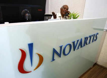 A man speaks on a telephone inside Novartis India headquarters in Mumbai April 1, 2013. REUTERS/Vivek Prakash