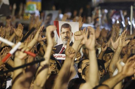 Members of the Muslim Brotherhood and supporter of ousted Egyptian President Mohamed Mursi shouts slogans at the Raba El-Adwyia mosque squar