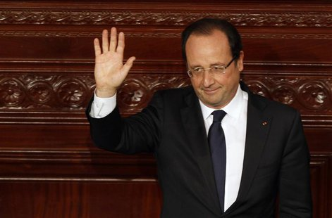 France's President Francois Hollande waves after delivering a speech at the Constituent Assembly in Tunis July 5, 2013. REUTERS/Zoubeir Soui