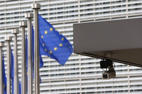 A security camera is seen at the main entrance of the European Union Commission headquarters in Brussels July 1, 2013. REUTERS/Francois Leno
