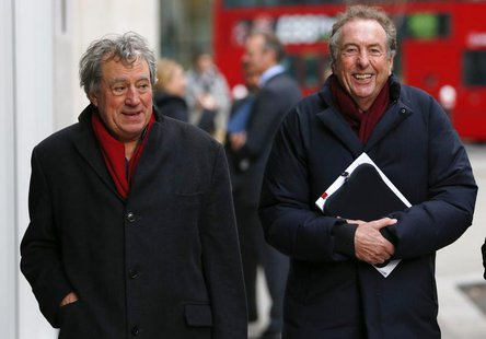 Monty Python members Eric Idle (R) and Terry Jones return to the High Court after a lunch break in central London December 4, 2012. REUTERS/