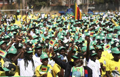 Supporters cheer Zimbabwean President Robert Mugabe as he arrives to launch his ruling ZANU PF party's election manifesto in the capital Har