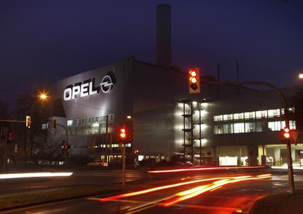 Vehicles drive past the Opel plant in Bochum April 17, 2013. REUTERS/Ina Fassbender
