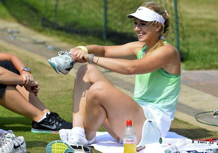 Sabine Lisicki of Germany sits on the ground during a training session on a practise court at the Wimbledon Tennis Championships, in London