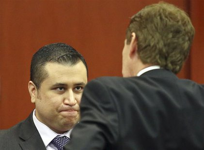 George Zimmerman chats with his defense attorney Mark O'Mara (R) during an early morning recess in his secondnd-degree murder trial in the f