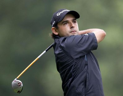 Paraguay's Fabrizio Zanotti plays a shot on the fourth hole on the final day of the KLM Open Golf Tournament in Hilversum September 12, 2010