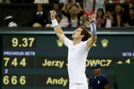 Andy Murray of Britain celebrates after defeating Jerzy Janowicz of Poland in their men's semi-final tennis match at the Wimbledon Tennis Ch