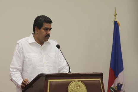 Venezuela's President Nicolas Maduro talks to the media during a news conference in Port-au-Prince, in this handout photo provided by Mirafl