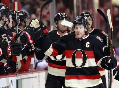 Ottawa Senators' captain Daniel Alfredsson celebrates his goal against the Tampa Bay Lightning during the first period of their NHL hockey g