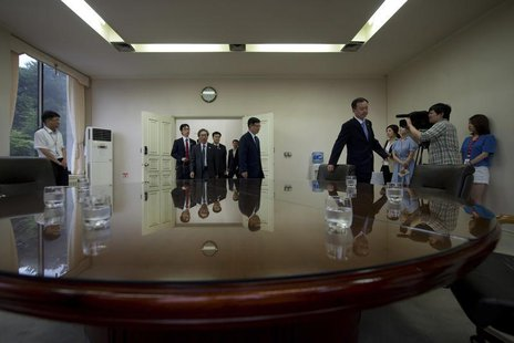 Suh Ho (centre R), head of the South Korean working-level delegation, leads his colleagues to a meeting as they prepare to depart for the No