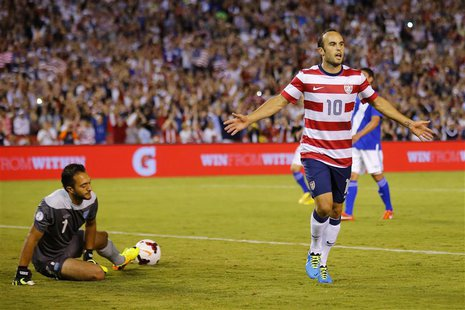 U.S. forward Landon Donovan (10) celebrates scoring against goalie Ricardo Jerez of Guatemala on a penalty kick during their friendly soccer