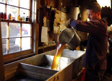 Steve Randle pours freshly made maple syrup in the finishing pan at Hollis Hills Farm in Lunenburg, Massachusetts in this February 19, 2012