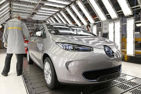 An employee inspects a Renault Zoe electric car on the production line at the Renault automobile factory in Flins, west of Paris, May 28, 20
