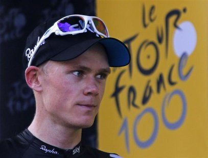 Team Sky rider Christopher Froome of Britain arrives on the podium after he won the 195 km eight stage of the centenary Tour de France cycli