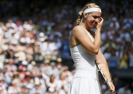 Sabine Lisicki of Germany cries as she is interviewed on Centre Court, after receiving her runners-up trophy, after being defeated by Marion