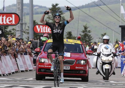 Team Sky rider Christopher Froome of Britain celebrates as he wins the 195 km eight stage of the centenary Tour de France cycling race from