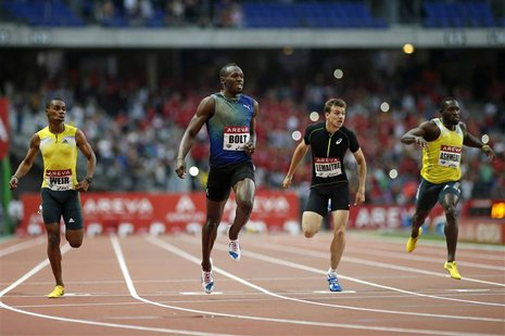 Usain Bolt of Jamaica crosses the finish line to win the men's 200 metres event during the IAAF Diamond League athletics meeting at the Stad