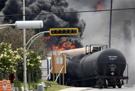 A burning train wagon is seen after an explosion at Lac Megantic, Quebec, July 6, 2013. REUTERS/Mathieu Belanger
