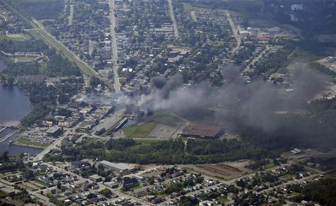 Smoke rises after a train explosion in the town Lac Megantic July 6, 2013. REUTERS/Mathieu Belanger (CANADA - Tags: DISASTER ENERGY)