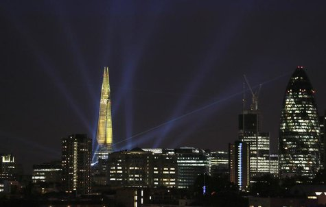 A laser beam touches the Gherkin from the Shard during the laser and searchlight show which marks the completion of the exterior of the Shar