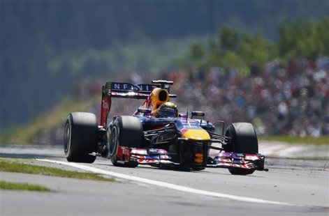 Red Bull Formula One driver Sebastian Vettel of Germany drives during the German F1 Grand Prix at the Nuerburgring circuit, July 7, 2013. RE