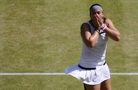 Marion Bartoli of France celebrates after defeating Sabine Lisicki of Germany in their women's singles final tennis match at the Wimbledon T